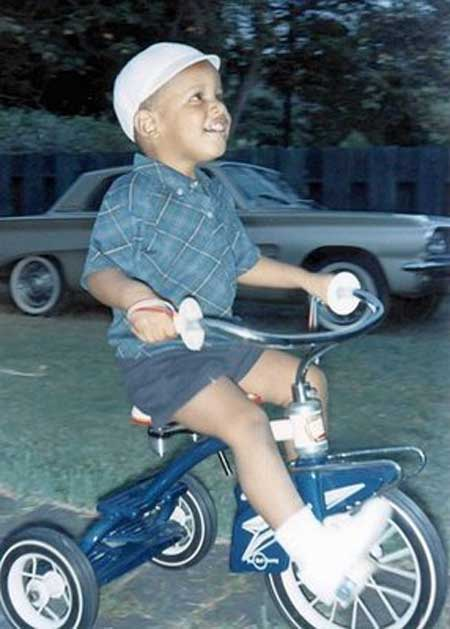 President-Barack-Obama-as-a-child-riding-a-tricycle