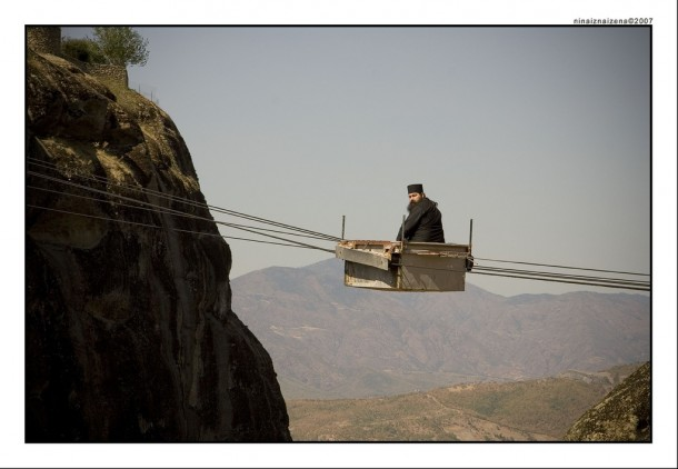 A Greek monk travels to his monastery via aerial tramway.