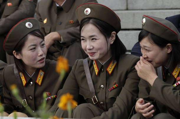 North Korean soldiers share a laugh.