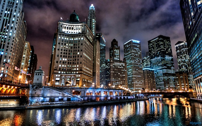 Chicago and the Chicago River at night.