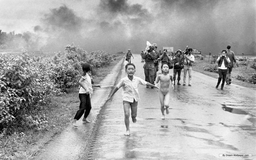 Vietnamese children fleeing from the smoke (possibly napalm).