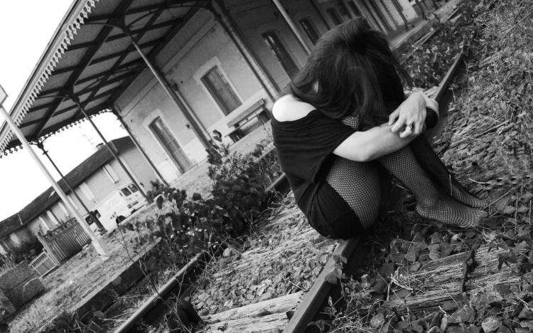 Sad girl on railway track
