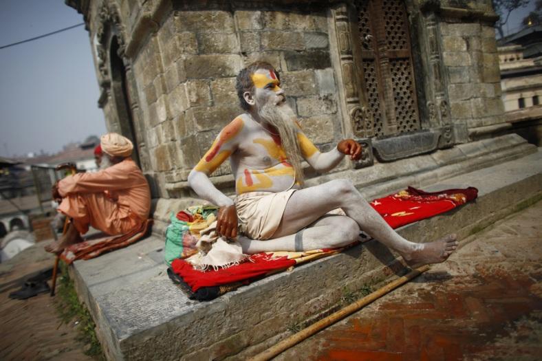 Hindu holy man resting at a temple.