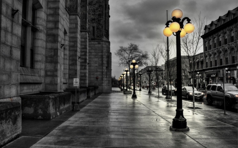 A city street in the early evening.