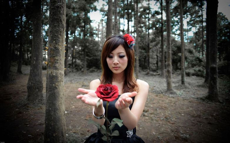 Asian woman with rose
