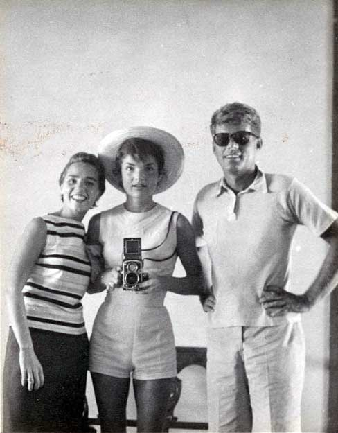 Jackie Kennedy taking a selfie in the mirror with Ethel Kennedy and John F. Kennedy in 1954.