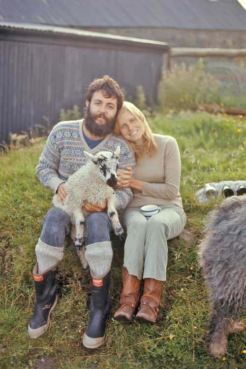 Paul McCartney and Linda McCartney poses with a lamb on their farm in Mull of Kintyre, 1970.