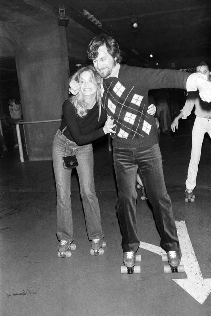 Goldie Hawn and Steven Spielberg roller skating, 1980.