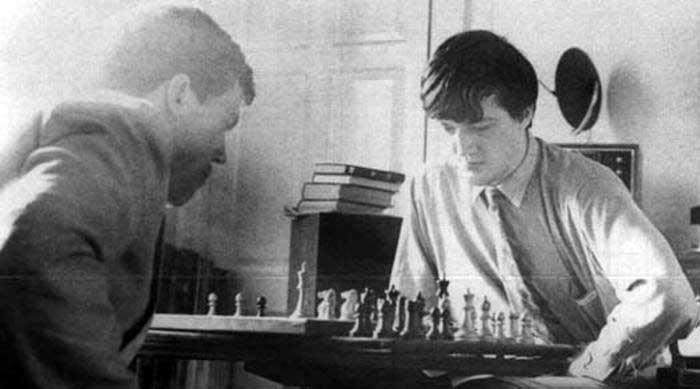 Hugh Lauri and Stephen Fry playing chess in Fry's rooms at Cambridge, 1980.