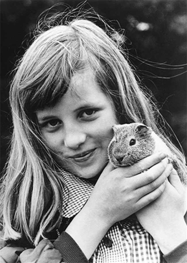 A young Princess Diana and her guinea pig Peanuts.