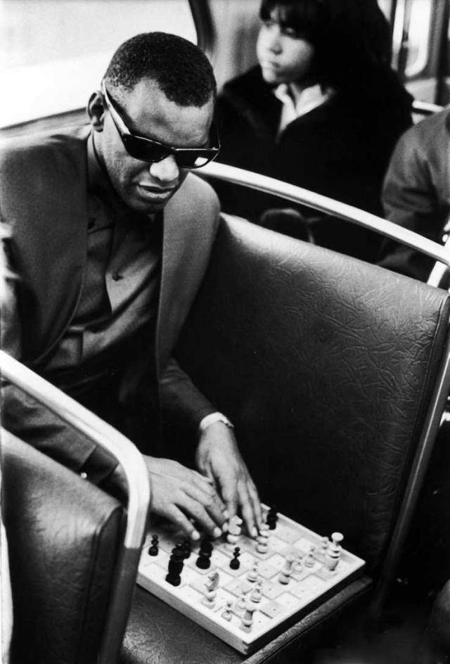 Ray Charles playing chess on a bus, 1966.