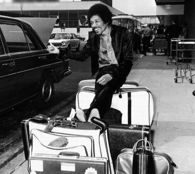 Jimi Hendrix trying to get a lift from Heathrow Airport, 1970.