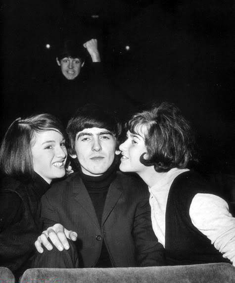 Paul McCartney photo bombing George Harrison