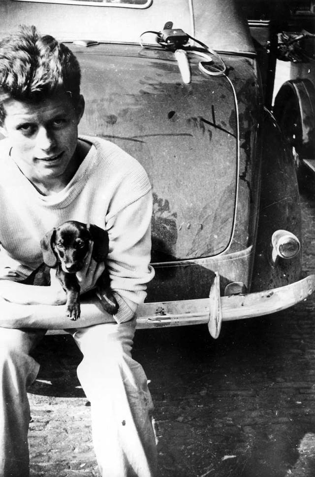 John F. Kennedy with his dog Dunker, 1937.
