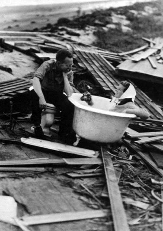 Katherine Hepburn in her bath tub after the Great New England Hurricane that destroyed her house. 95% of her personal belongings were either lost or destroyed, including her 1932 Oscar, which was later found.