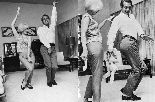 Joanne Woodward and Paul Newman showing off some dance moves.