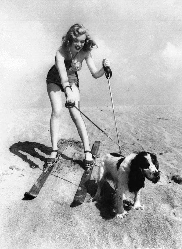 Marilyn Monroe wearing skis at the beach with her dog Ruffles, 1947.