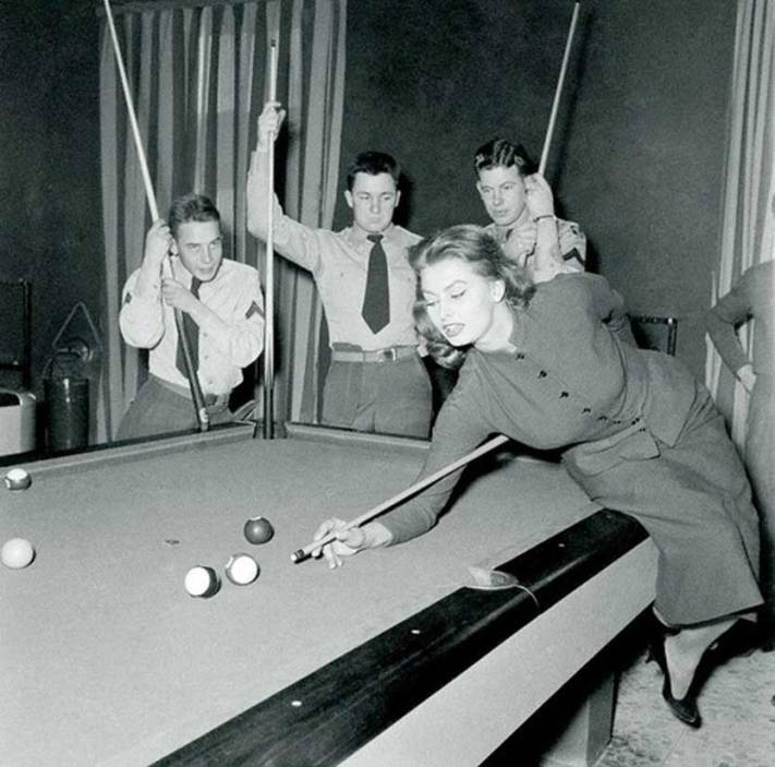 Sophia Loren playing pool, 1954.