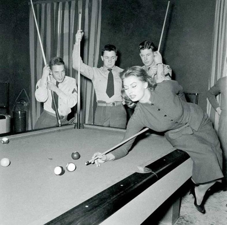 Sophia Loren playing pool, 1954.