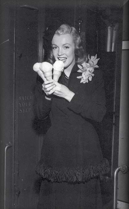Marilyn Monroe with three ice cream cones.