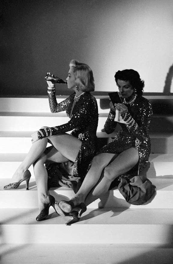 Marilyn Monroe and Jane Russell taking a break on the set of Gentlemen Prefer Blondes.
