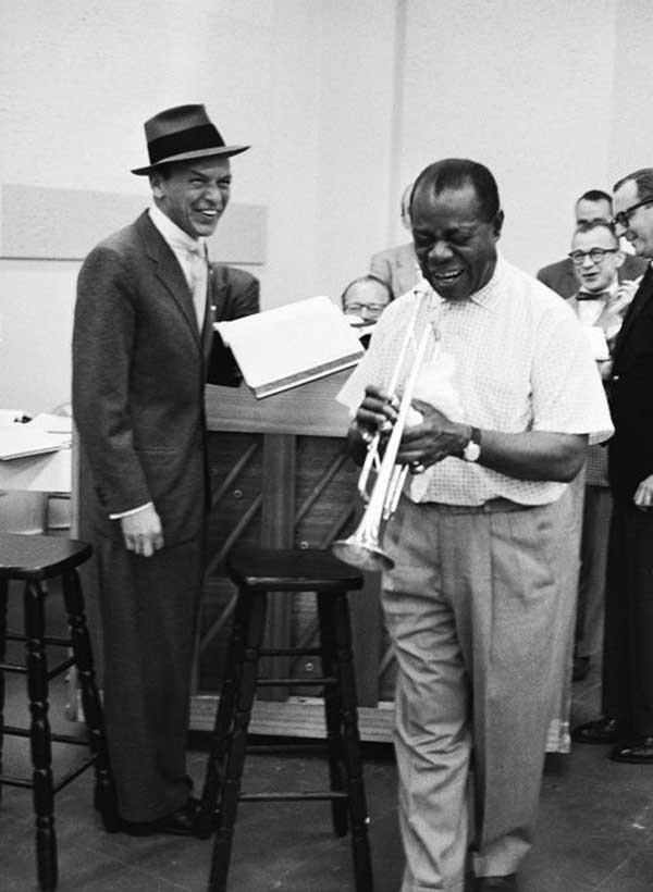 Frank Sinatra and Louis Armstrong having a laugh during the rehearsal for The Edsel Show, 1957.